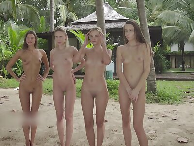 4 Stark naked Girls insusceptible to a fotoshoot at Beach